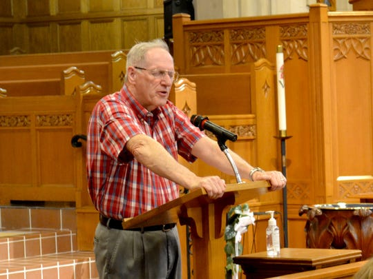 Pastor Bill Walk of First United Church of Christ leads