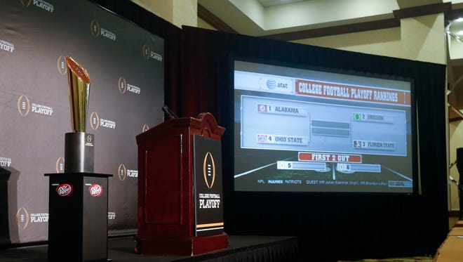 The top four in the college football playoff rankings are unveiled on ESPN on a big screen at the Gaylord Texan Hotel.