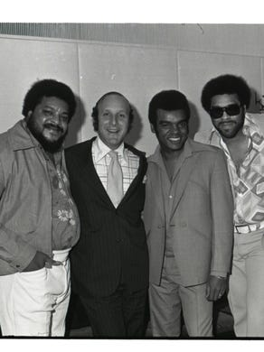 The Isley Brothers with record executive Clive Davis.