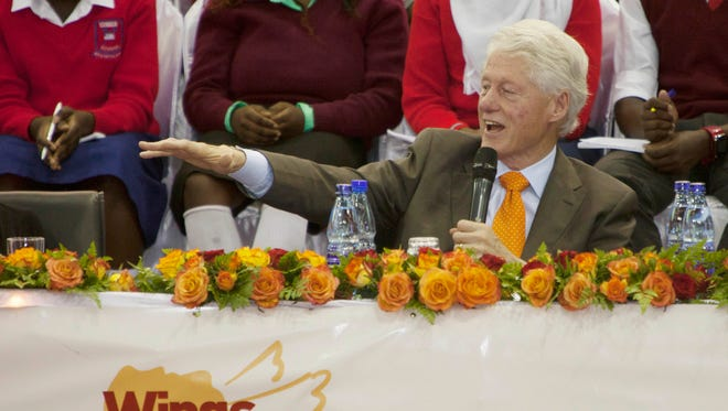In this May 2, 2015 file photo, former President Bill Clinton speaks at the Kasarani Sports Complex in Nairobi, Kenya, during a tour of Clinton Foundation projects in Africa. As Bill Clinton's presidency ended, he was popular, yet still tainted by scandal, and struggling to find his footing after eight years in the White House. He eventually channeled his energy into the global philanthropy that bears his name and has shaped so much of his post-presidential legacy.