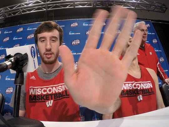 Wisconsin's Frank Kaminsky waves at a camera during the first half of the NCAA Final Four college basketball tournament championship game Sunday, April 5, 2015, in Indianapolis.
