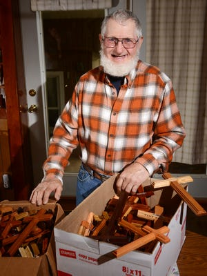 Tony Green with some of the more than 400 wooden crosses he made for soldiers deployed in the Middle East.