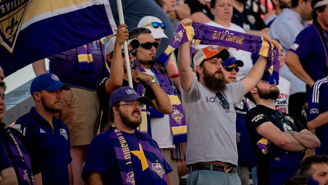 Fans cheer during Louisville City FC game against New England Revolution played at Lynn Stadium in Louisville, Ky, June 5, 2018.
