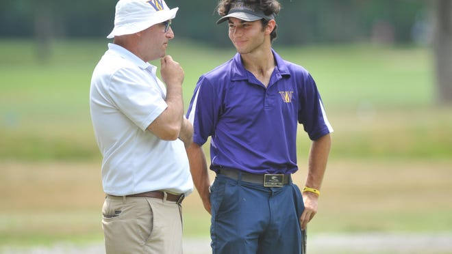The Wheeler School's Ben Sapovits, right, shares a smile with his father, Jay, after his win over Ethan Mossey Wednesday in the quarterfinal round of the RIGA Boys Junior Amateur Championship at Alpine Country Club in Cranston.