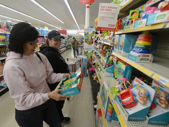 Sisters Christine Wands of Seaford and Cathy Vansciver of Seaford shop at 6 a.m. Thursday the Salisbury Kmart. The two venture out for Black Friday deals every year.