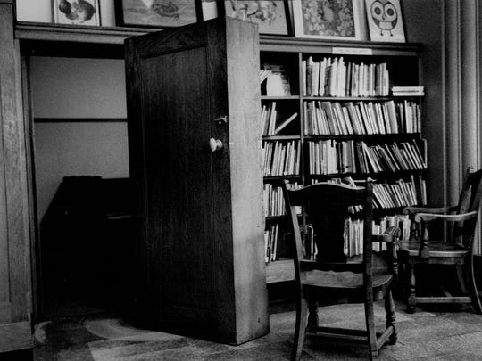 """A hidden doorway in a wall of books at the Rundel Library once served as the entryway to the """"Secret Room."""""""