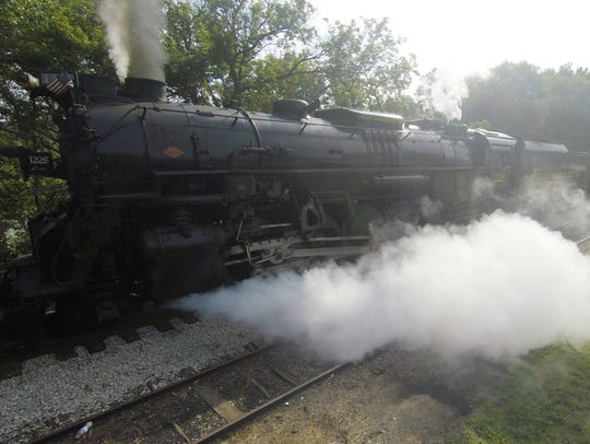 The Pere Marquette locomotive 1225 leaves the historic