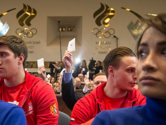 Russian athletes vote with their ballots during an Russian Olympic committee meeting in Moscow, Russia, Tuesday, Dec. 12, 2017. The Russian Olympic Committee formally gave its blessing Tuesday for the country's athletes to compete under a neutral flag at the upcoming Pyeongchang Games. (AP Photo/Ivan Sekretarev)