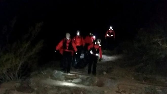 Members of the Palm Springs Mounted Police Search & Rescue team participate in a search for a body near a Palm Springs trail Saturday.