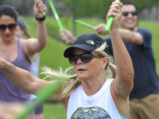 Kathy Moore leads a workout Saturday as part of the city's first-ever Open Streets Nashville festival in the Gulch.