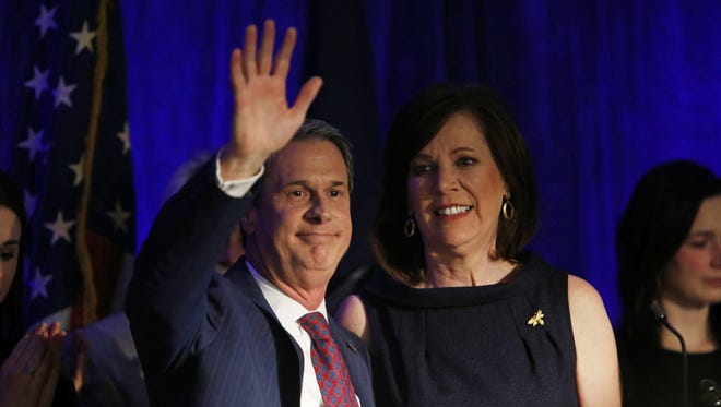 Louisiana gubernatorial candidate Sen. David Vitter, R-La., with his wife, Wendy, at his side, waves to supporters on election night in Kenner, La., on Saturday, Nov. 21, 2015. Vitter lost the race to Democrat John Bel Edwards.