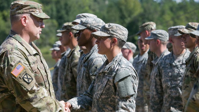 Capt. Kristen Griest graduates from the Army's Ranger School at Fort Benning, Ga., in August 2015.