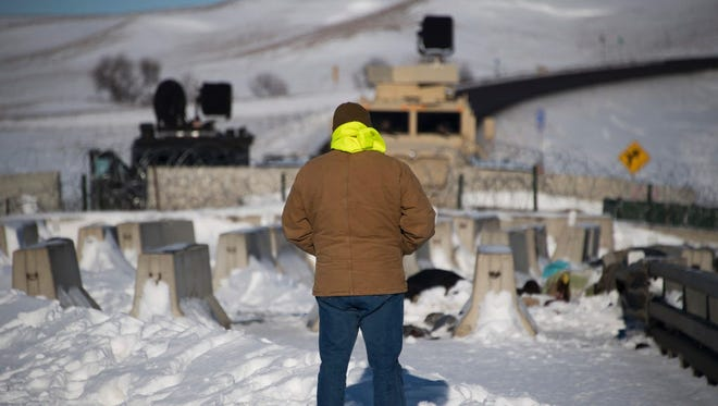 An activist stands by a police barricade near the Standing Rock Sioux Reservation on Dec. 4, 2016.