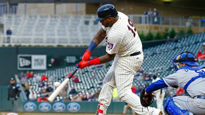 Minnesota Twins' Kennys Vargas, left, hits an RBI-single off Kansas City Royals relief pitcher Chris Young in the seventh inning during the second game of a baseball doubleheader Sunday, May 21, in Minneapolis.