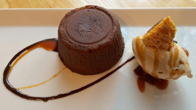The Molten Chocolate Lava Cake at King's Landing Bistro in Springdale is served with a Salted Caramel Gelato.