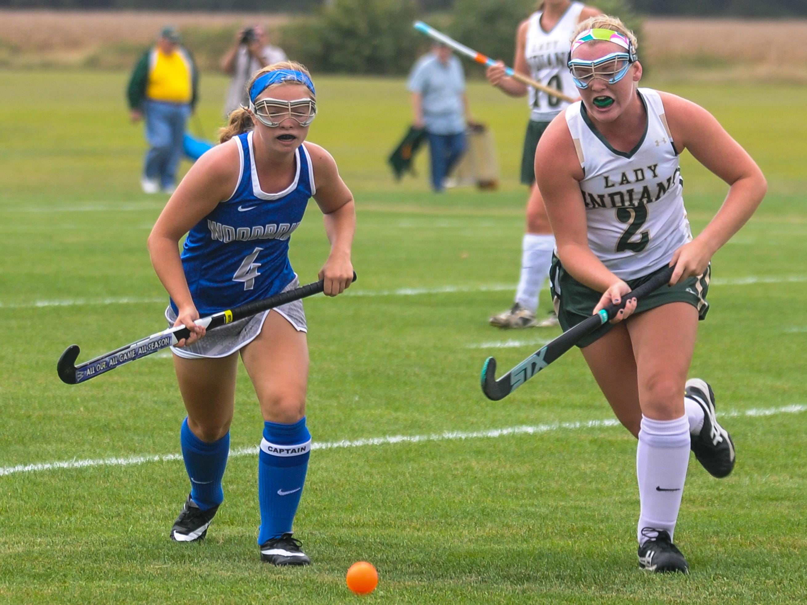 Indian River's Callie McDowell, right, works up field against Woodbridge on Tuesday afternoon in Dagsboro.