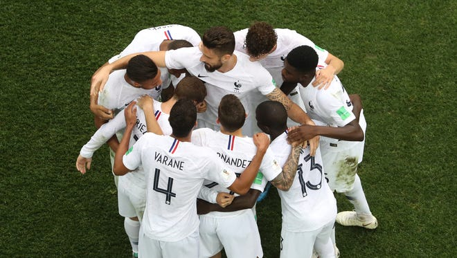 France players celebrate their second goal against Uruguay.