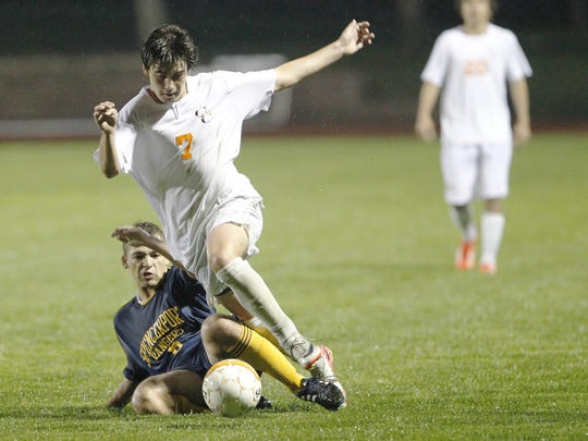 Lukas Fernandes, top, is a two-time All-Monroe County