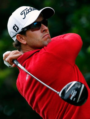 Adam Scott, seen here Friday, leads Rory McIlroy by four strokes.