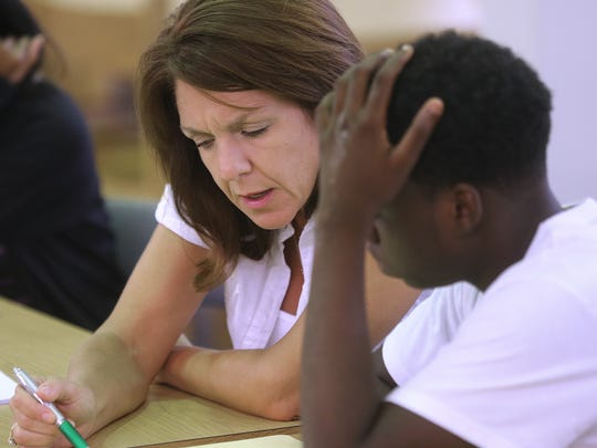 When she was a teacher, School Board member Alva Striplin helps summer school students with competing their summer course work.