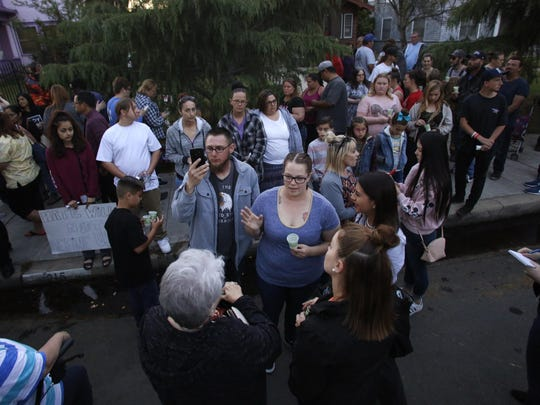 Stephanie Rodriguez, center, talks with family during a candlelight vigil Thursday, April 20, 2017 in Fresno, Calif.