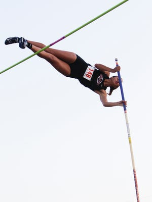"""Okemos senior Sophia Franklin pole vaults Tuesday, May 30, 2017, during the 2017 Honor Roll Meet at Sexton High School.  Franklin set a meet record of 13'1""""."""