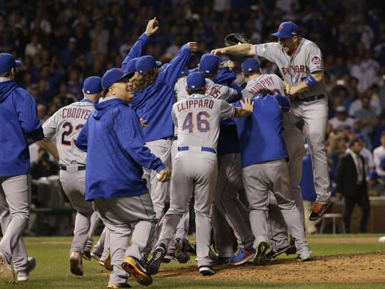 The New York Mets celebrate after Game 4 of the National League baseball championship series against the Chicago Cubs Wednesday, Oct. 21, 2015, in Chicago. The Mets won 8-3 to advance to the World Series.
