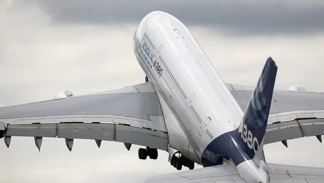 An Airbus A380 performs in an aerial flying display at the Farnborough International Airshow on July 16, 2014, in England.