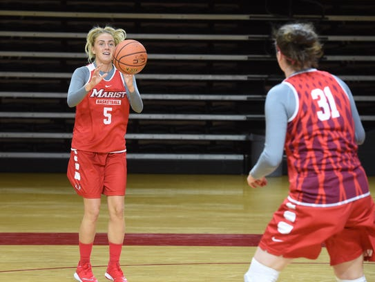 Marist's Lovisa Henningsdottir, left, catches a pass from teammate Molly Smith, right, during practice on Tuesday.
