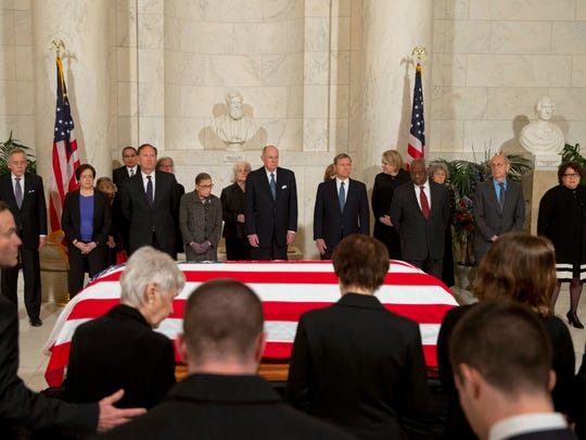 Supreme Court Justices Elena Kagan, Samuel Alito, Ruth Bader Ginsburg, Anthony Kennedy, John Roberts, Clarence Thomas, Stephen Breyer and Sonia Sotomayor look on as family members of the late Associate Justice Antonin Scalia take their seats for a private ceremony in the Great Hall of the Supreme Court on Feb. 19, 2016.