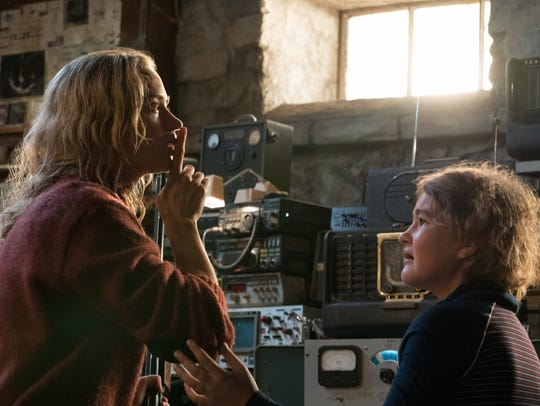 "Evelyn (Emily Blunt, left) implores her daughter Regan (Millicent Simmonds) to remain quiet in the horror thriller ""A Quiet Place."" The hit has a shot at a best picture nomination."