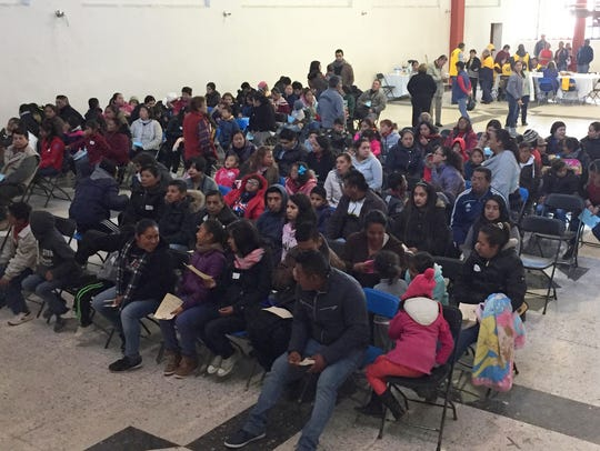 Scores of Mexican residents wait in a public building