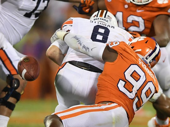 Clemson defensive lineman Clelin Ferrell (99) strips