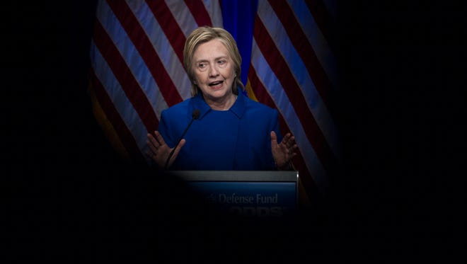 Hillary Clinton is seen thru two chairs as she addresses the Children's Defense Fund's Beat the Odds celebration at the Newseum in Washington, Wednesday, Nov. 16, 2016.