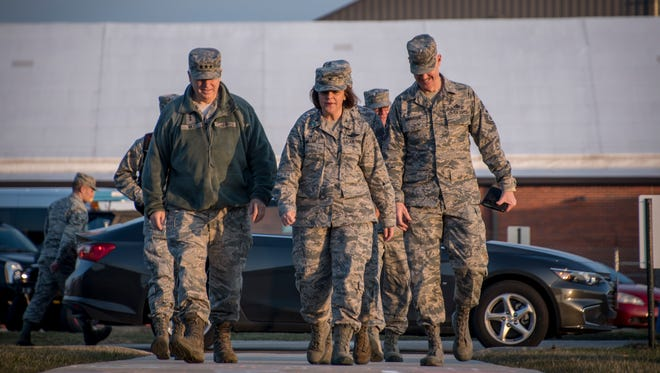 """U.S. Air Force Lt. Gen. L. Scott Rice, director, Air National Guard, and Chief Master Sgt. Ronald Anderson, Command Chief of the Air National Guard, are greeted by Col. Allison C. Miller as they arrive for a visit to the 179th Airlift Wing on April 11. Rice met with leadership and visited Airmen across the wing to learn about their mission and ended the visit with an """"All Call"""" event where several Airmen were recognized for recent achievements. ()"""