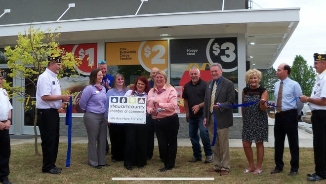 Members of the Stewart County Chamber of Commerce help mark completion of remodeling at McDonald's in Dover with a ribbon-cutting ceremony.