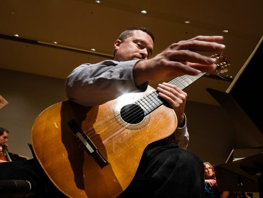 Guitarist Jesse Langen rehearses with the St. Cloud