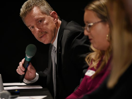 "Sheriff's Lt. Mark Gist, left, makes a point during a panel discussion about the new Domestic Violence High Risk Team in Tulare County Monday, Nov. 13, 2017 during 210 Connect at 210. ""It can be a transforming moment when the deputy tells the victim he fears for her life,"" Lt. Gist said. ""We encourage victims to seek advocacy."""