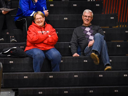 Dawn Schenk  shares a row with former men's basketball head coach Kevin Schlagel during a St. Cloud State University women's basketball game Wednesday, Feb. 21, at Halenbeck Hall in St. Cloud.