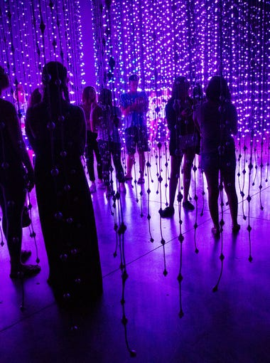 Visitors experience the Ocean of Light exhibit at the Scottsdale Museum of Contemporary Art Aug. 16, 2017.