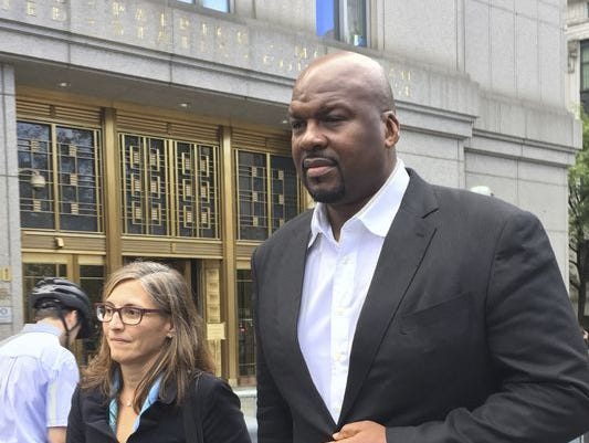 In this Oct. 10, 2017, file photo, Chuck Person leaves Manhattan federal court in New York. Auburn has fired associate head basketball coach Chuck Person, who has been indicted on federal bribery, conspiracy and fraud charges. The university announced the move Wednesday, Nov. 8, 2017, a day after Person and seven others were indicted by a federal grand jury in New York City.