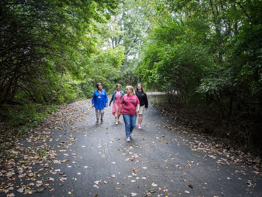 The Youth Opportunity Center's walking club walks a