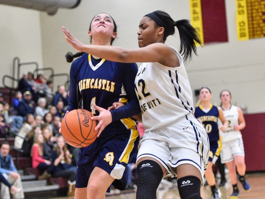 Greencastle's Jenay Faulkner (4) scored 34 of the team's
