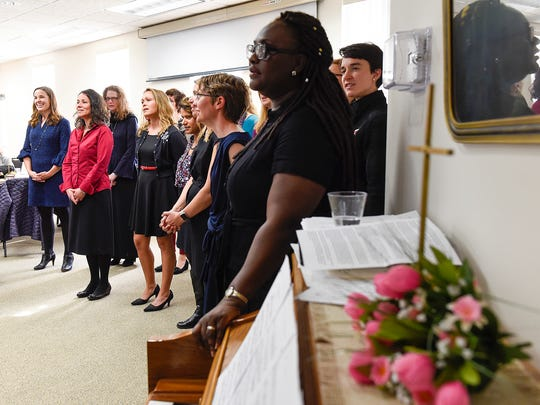 Mettekor, a community choir, sings and shares memories of Mette Kirsch, its founder, after her memorial service Friday, April 28, at the Trinity Lutheran Church in Sauk Rapids. Kirsch died of cancer in March.