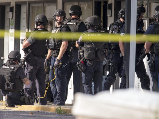 IMPD SWAT officers work a hostage situation at the Gateway Motel, near 16th and Lafayette Road, that ended after four hours and the peaceful surrender of a man, who was holed up in the motel with his girlfriend, Indianapolis, Wednesday, June 21, 2017.
