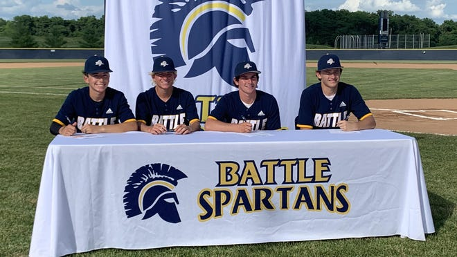 Battle baseball seniors, from left to right, Braydon Boyer, Carson Fewell, Kellen Williamson and Nathan Browning pose for a photo Thursday during a signing ceremony.