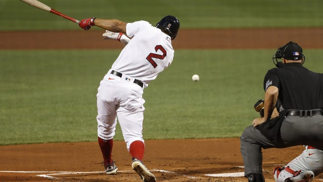 Boston's Xander Bogaerts hits an RBI single against Philadelphia Phillies in the first inning of Tuesday's game.