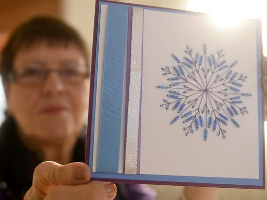 Artist Lorraine Dooner shows off a hand made beaded