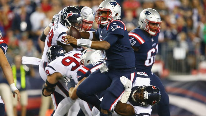 Benardrick McKinney of the Houston Texans tackles Jacoby Brissett of the New England Patriots during the first half at Gillette Stadium on Sept. 22.