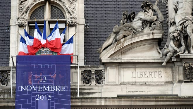 """A banner reading """"November 13, 2015,"""" in memory of the victims of last year's terrorist attacks in and around Paris that left 130 people dead, is on the facade of Paris' City Hall on Nov. 10, 2016."""
